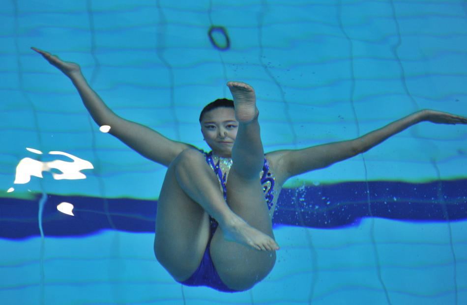 Yvanna Lei (Sydney Emeralds) makes a figure underwater during her routine in the open senior free...