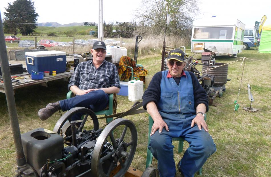Warren Bloxham (left), of Timaru, and Brian Smith, of Winchester, man the vintage machinery site at the Otago Field Days. Photos: Alice Scott