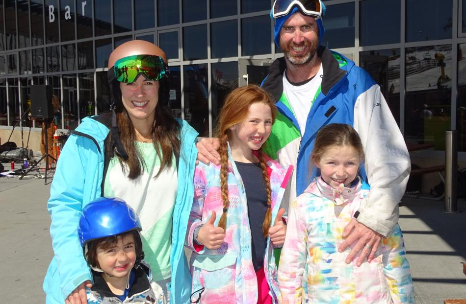 Rachel and Cookie Thurston with their children Sebby (4), Shiloh (11) and Zoe (8), all of...
