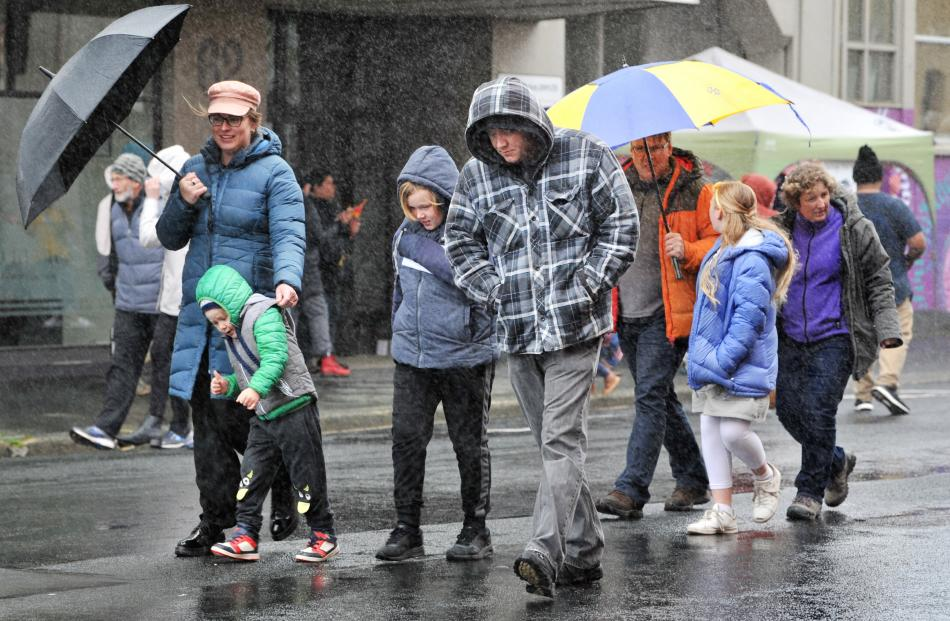 Revellers battled the elements to head to the Vogel Street Party on Saturday.