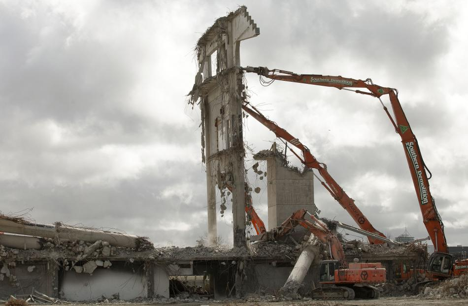 The last structure at Lancaster Park, part of the Paul Kelly stand, is demolished. Photos: Geoff...
