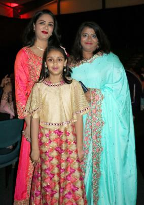 Nidhi and Mishka (8) Singh with Sunitha Karunakaran, all of Queenstown.
