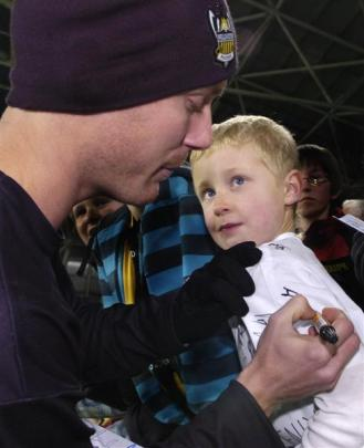 Jimmy Downey signs a shirt for Hamish Mair (8).