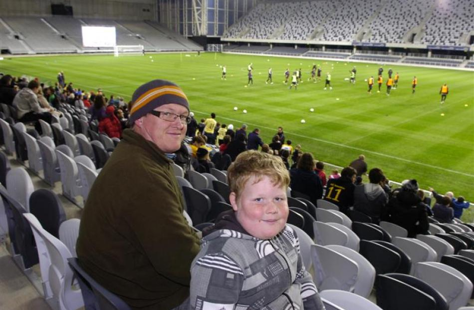 Kirk and Sean (10) Davidson watch the players train from the South Stand.