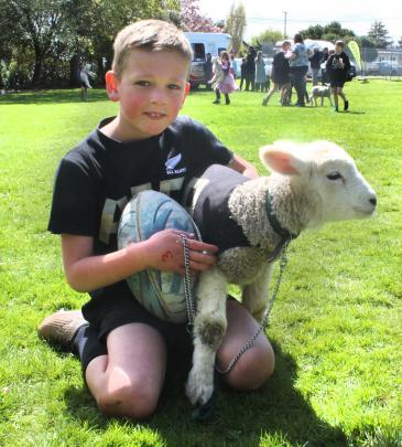 Luke Horrell and his pet lamb Cutie. PHOTOS: LUISA GIRAO