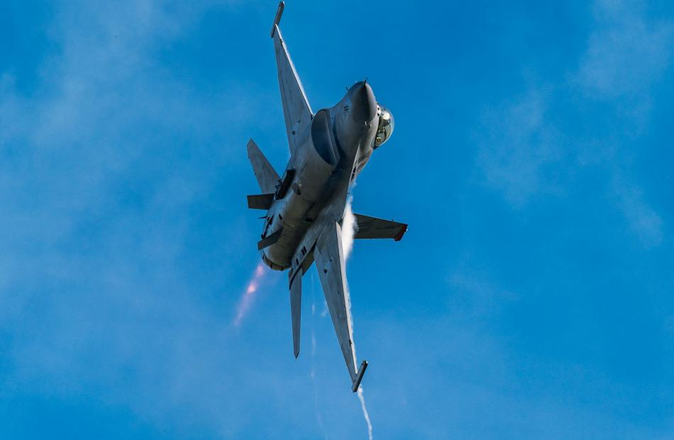 The USAF F-16 fighter jet demonstration team out of Misawa Air Force base in Japan displaying at...