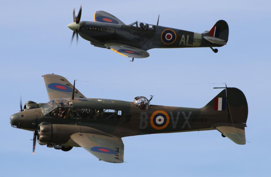 The beautifully restored Avro Anson (foreground) and Spitfire in formation over Warbirds Over...