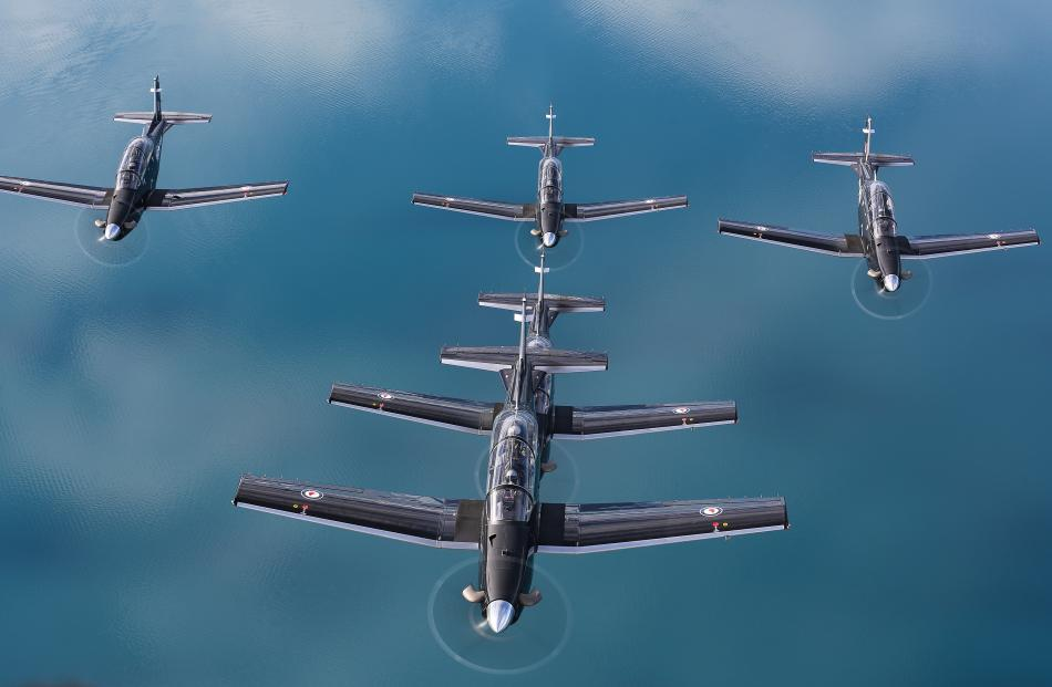 The RNZAF's formation aerobatic team, the Black Falcons, pictured over Lake Wanaka