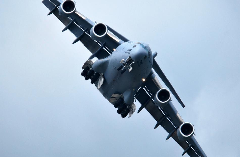 The USAF massive C-17 military transport aircraft comes in low over Wanaka airfield
