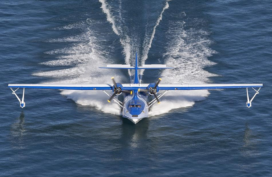 The Catalina Flying Boat lands on Lake Wanaka as part of the Community Airshow late on the Friday...