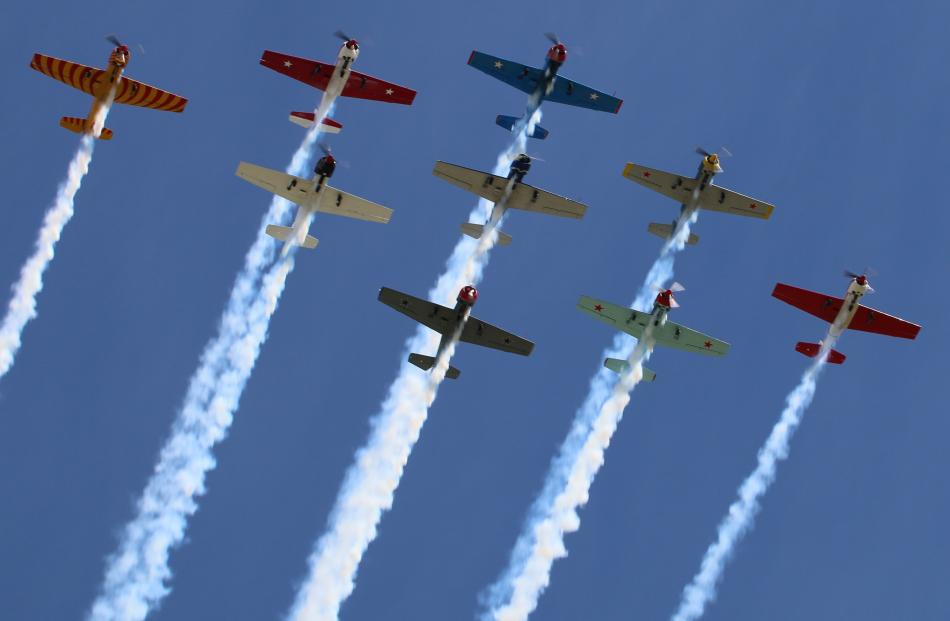 The 9-ship Yak-52 Formation Aerobatics team