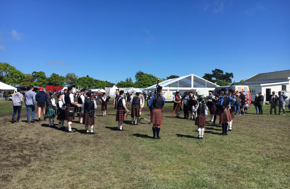 The Ellesmere Highland Pipe Band warms up before the grand parade.