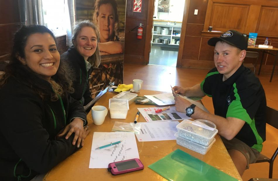 Ray Mohammed (left) and Rebecca Johnston, both of Dunedin, put the hard questions to Adam Kelly,...