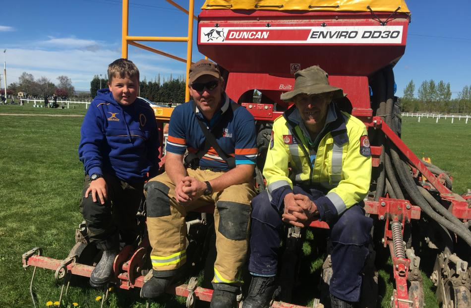 Lachlan Macaulay (11) and Middlemarch rural fire brigade volunteers Cameron Macaulay and Philip...