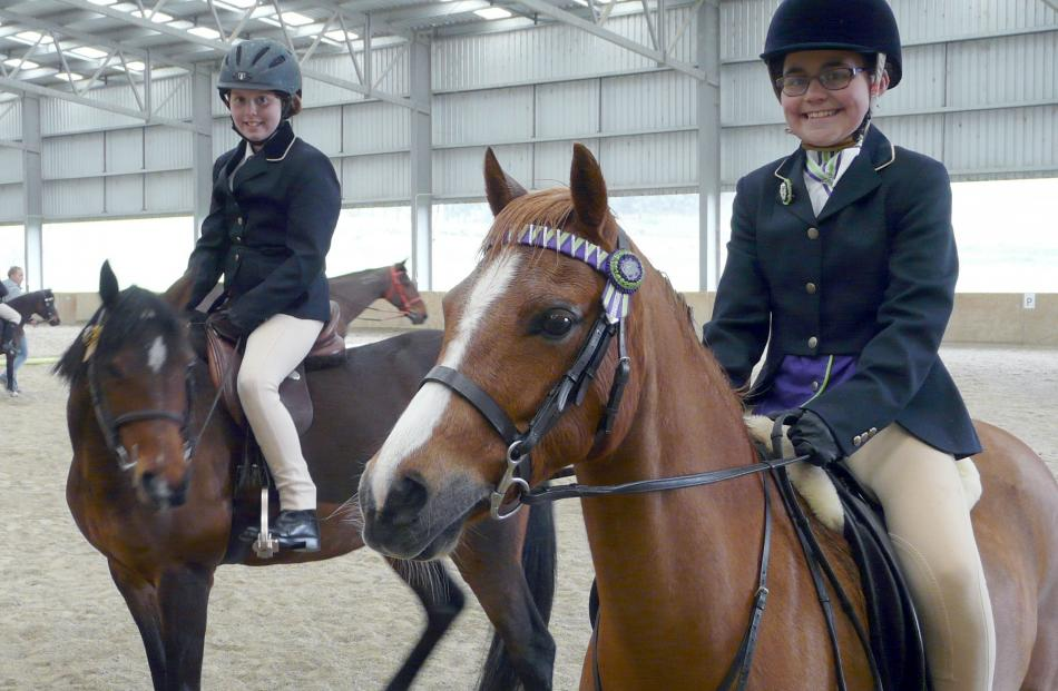 Ramsey Ashworth (left, 10) and Nicole Reid (12), both of Dunedin, have fun at the show.