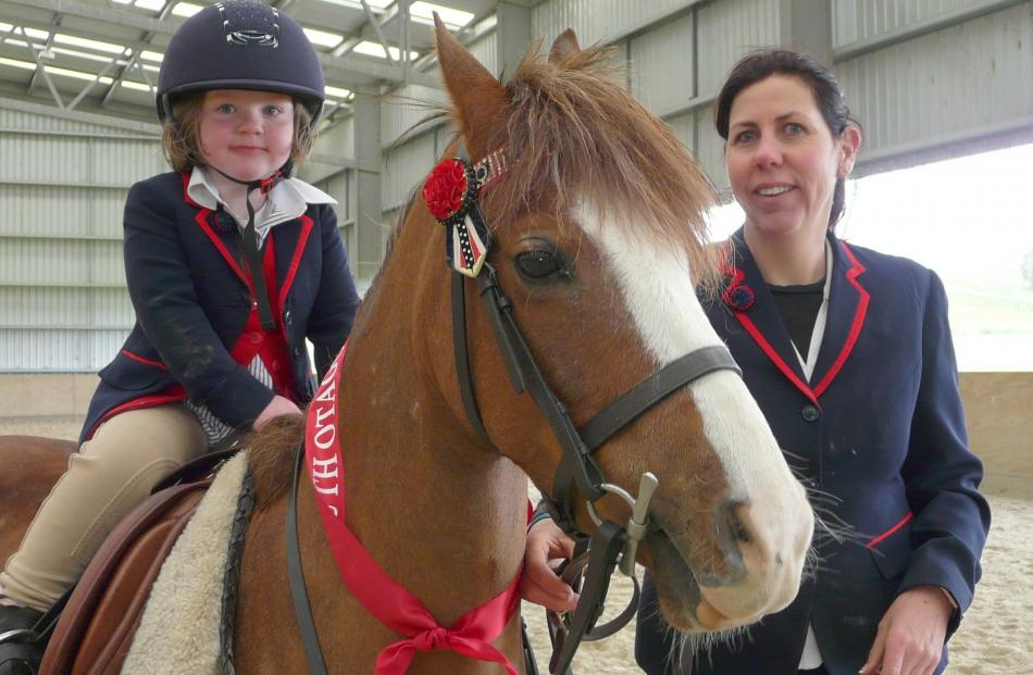 Caitlyn Blaikie (4), and mum Amy, of Mokoreta, believe in learning equestrian skills at an early...