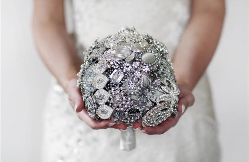 Not flowers this time, but an artful bouquet of jewels for bride Sophie Trevathan, who married...