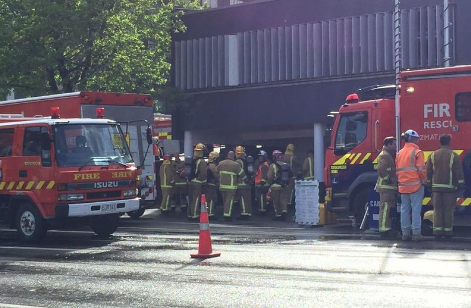 Firefighters with breathing appartus assembling on Hobson St. Photo: NZ Herald
