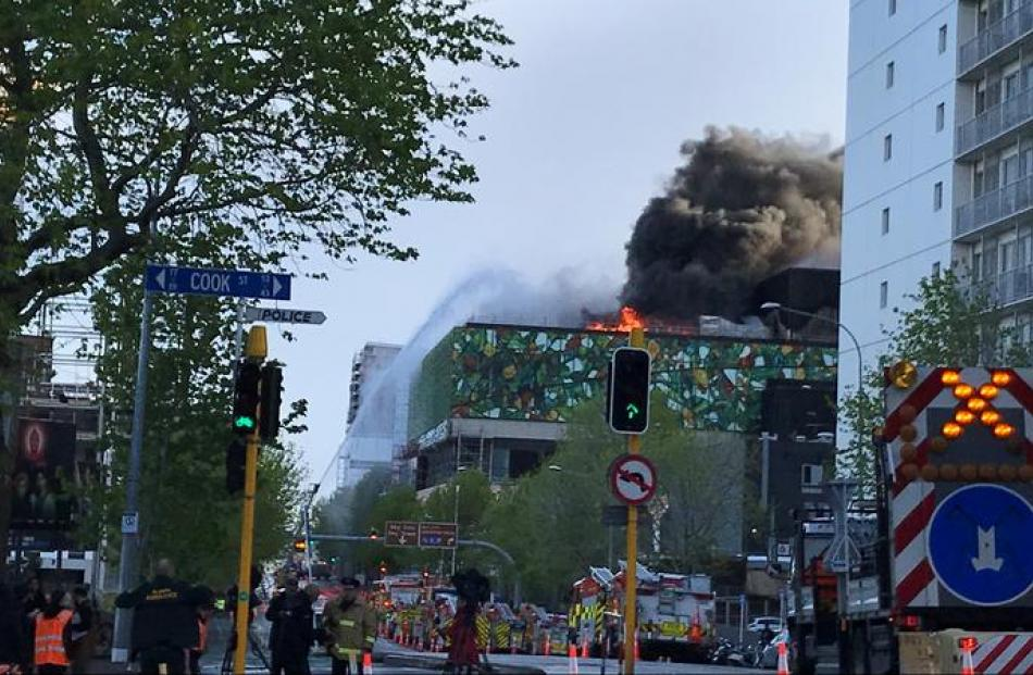Flames and smoke continued to pour forth from the building this morning. Photo: RNZ