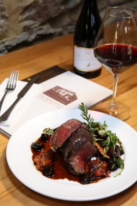 A peppered stonefruit venison loin dish featured at Ophir's Pitches Store as part of the Eat....