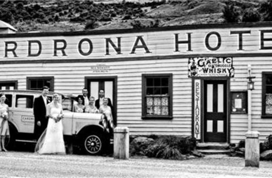 Hayden Fry and Louise Horrell and their attendants at their wedding at the Cardrona in January....