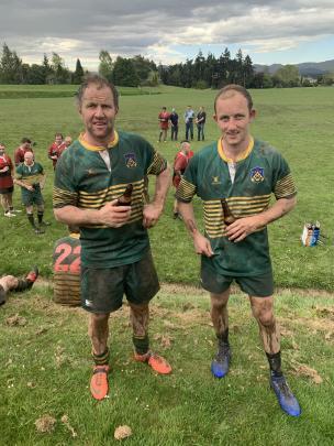 Waikouaiti rugby teammates Allan (left) and son Daniel Oldham enjoy a post-match refreshment.
