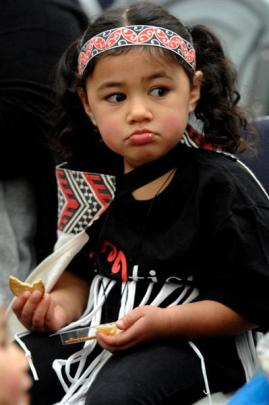 Jade Taani (3), from Early Learning on London, has a snack while enjoying the  action.
