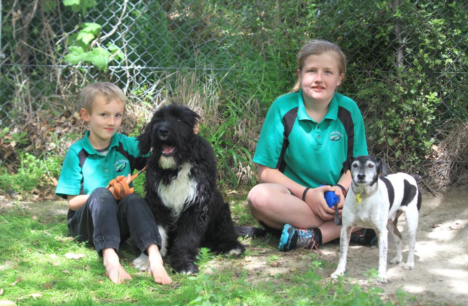 Owen Anderson (6), of Herbert, with Hank, and Gemma Ludemann (13), of Maheno, with Jack.PHOTOS:...