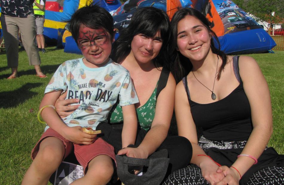 Filipe Silva (7), Patricia Cisternas and Anais Araya, all of Alexandra.