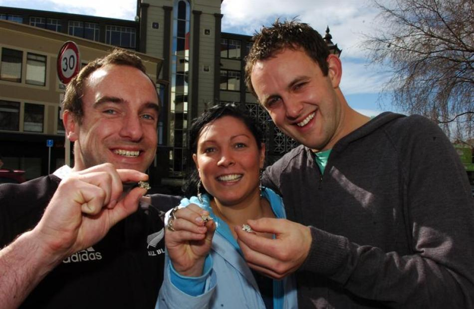 Greg Giles, of Dunedin, his fiancee Laura Devine, of Ireland, and friend Darryl Sutton proudly...