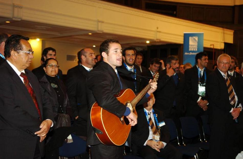 Pumas wing-centre Agustin Gosio leads his team in a song during their official capping ceremony....