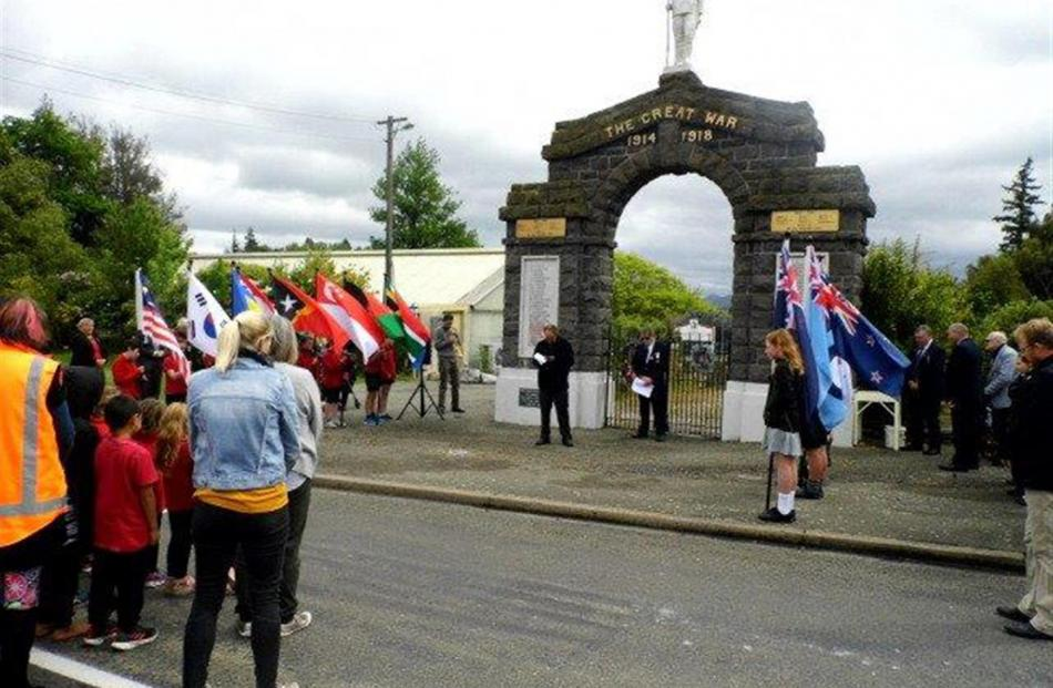 orrisons farmer Paul Paton (left) recites a prayer at the Palmerston war memorial yesterday as...