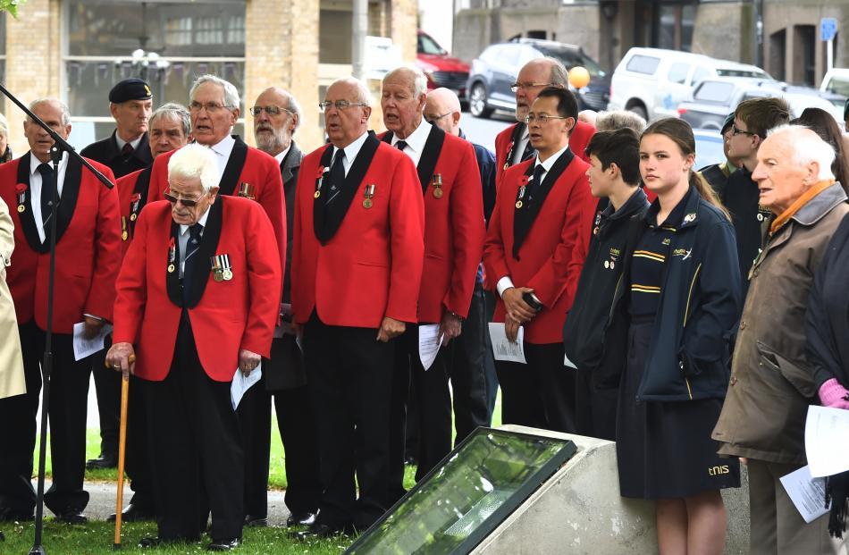 The Dunedin RSA choir sings during the service.