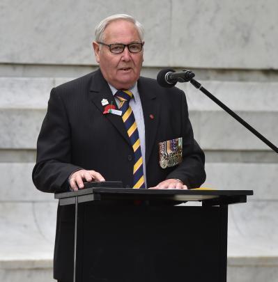 Dunedin RSA president Lox Kellas addresses Dunedin's Armistice Day service yesterday.