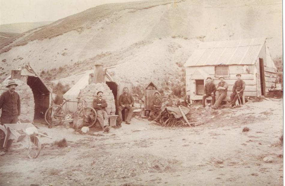 Gold workers at the dredge camp in the upper Nevis Valley in 1903 (from left) Johnston, E....