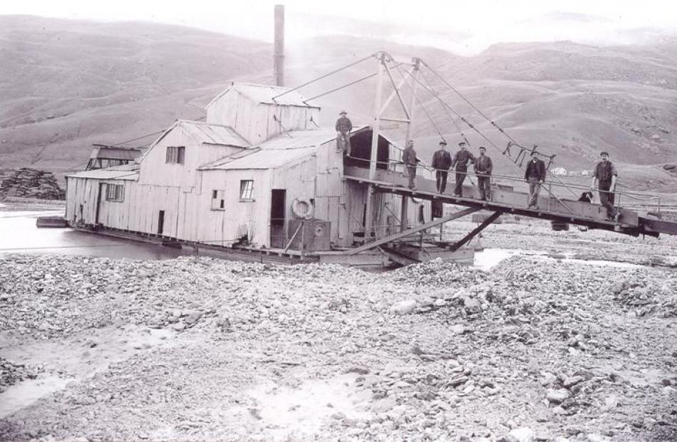 On the dredge 'Crewe No 2' in the upper Nevis Valley in 1903 are (from left) Jack McNulty, Harry...