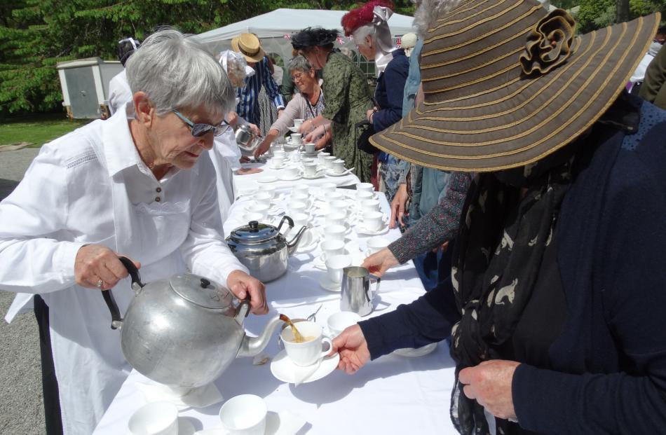 Doreen Stackhouse, of Oamaru, pours tea.