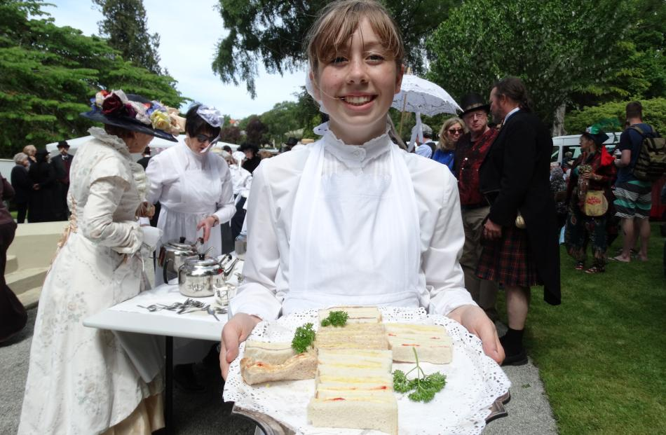 Holly Dickson (14), of Oamaru, does the rounds with her tray of sandwiches.
