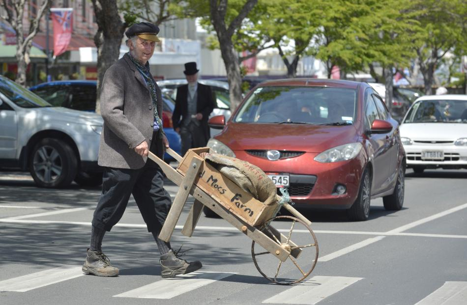 Keith McQuillan carefully pushes his wares across Thames St yesterday.