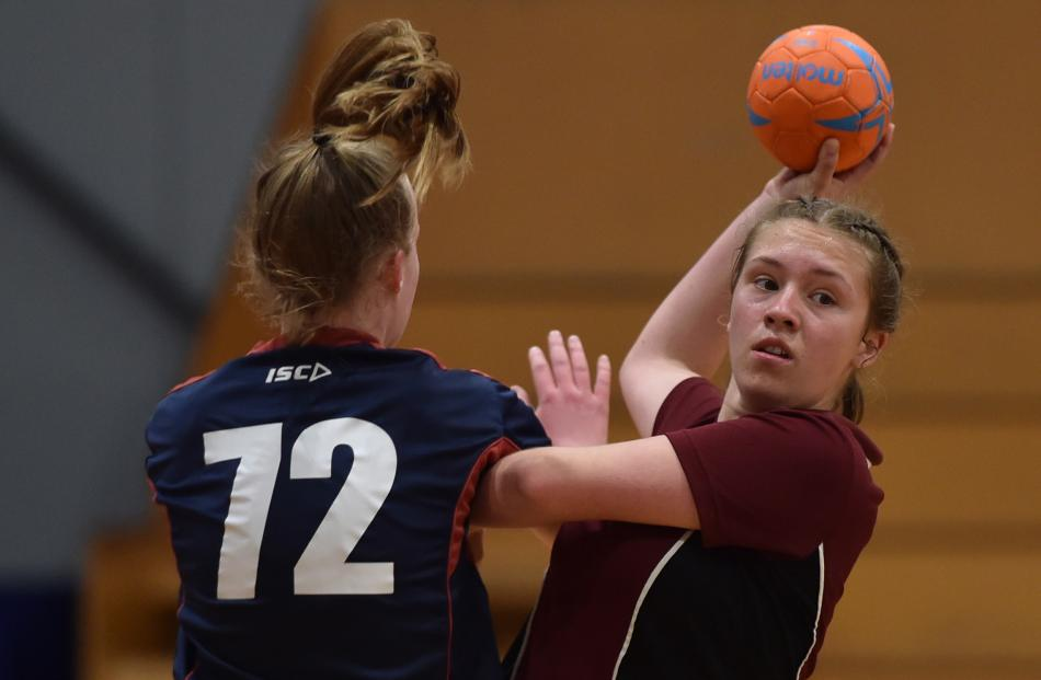 Logan Park High School's Grace Jones (15) looks to move the ball despite the the attention of...