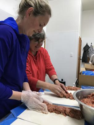 Emily Jones (left) and Trudy Lindsay begin an assembly line.