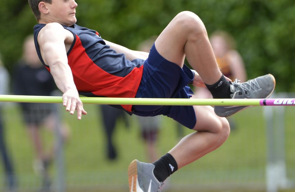 Liam Barron, of Balmacewen Intermediate, clears the bar in the 13 and over boys high jump.
