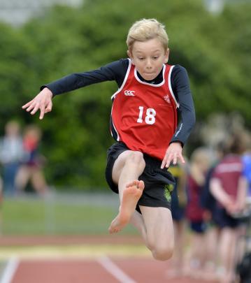 Finn Jones, of Fairfield School, competes in the boys under-12 long jump.