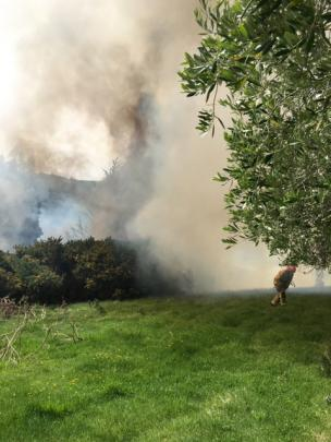 Smoke from the fire on Scroggs Hill smothers the area. Photo: Supplied