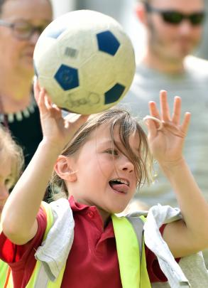 Musselburgh School pupil Lilly MacDonald (7) throws a ball during the safari fun day.
