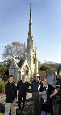 Marcus Wainwright, Guy Williams, Stewart Harvey and Peter Mackenzie in front of the restored tomb.