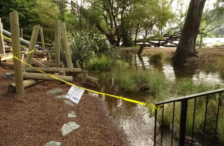 Part of the children's playground in Queenstown Bay was closed yesterday after being partly submerged by Horne Creek. Photo: Guy Williams