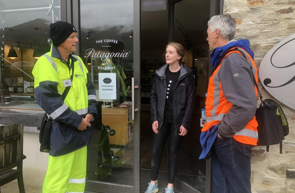 Queenstown Lakes district emergency management officer Trevor Andrews and Deputy Mayor Calum MacLeod talk with Kate Donaldson, an employee at Patagonia Chocolates, one of the businesses in the flood risk area of Wanaka lakefront they visited yesterday aft
