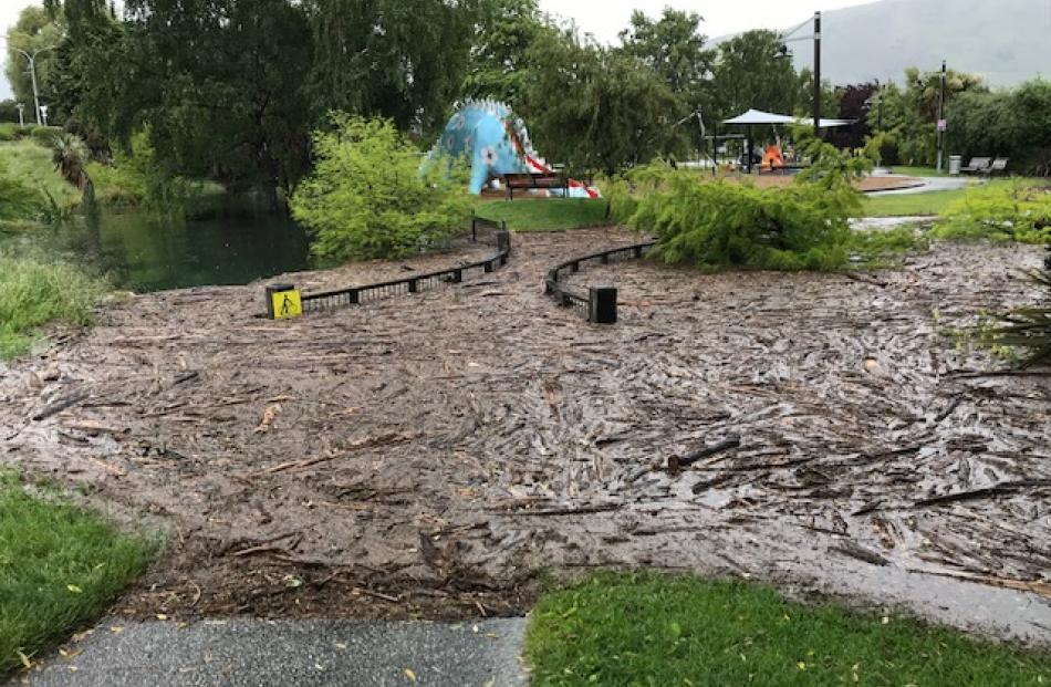Debris from Lake Wanaka has back-filled Bullock Creek and the bridge alongside the lakefront...