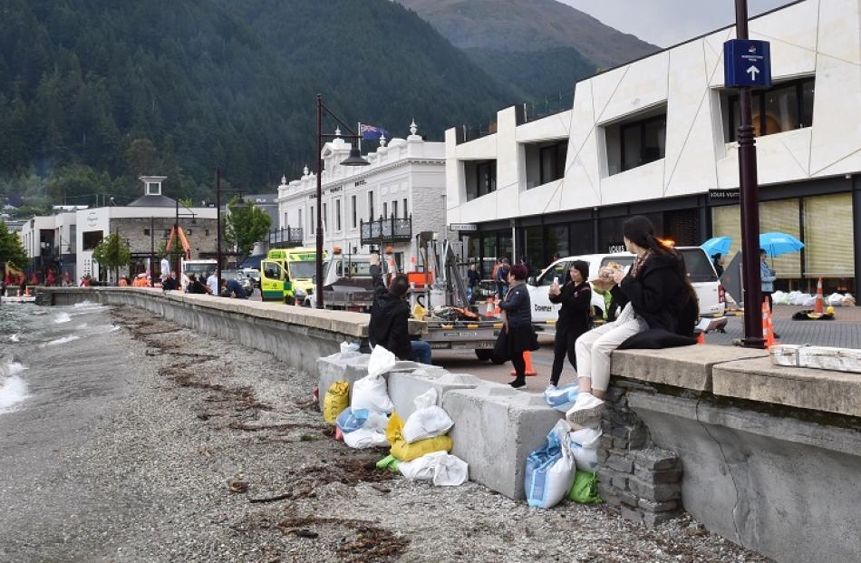 Tourists on a sandbagged wall in Queenstown. Photo: Gregor Richardson